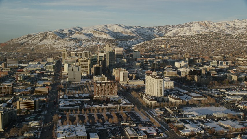 City Streets and Buildings with Winter Snow in Downtown Salt Lake City at Sunset Aerial Stock Footage | AX127_110