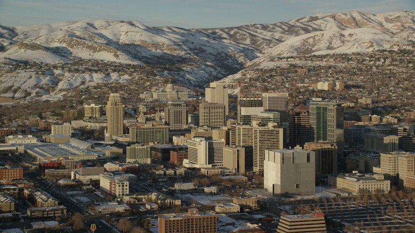 6K stock footage aerial video orbit of Downtown Salt Lake City and Utah State Capitol with winter snow at sunset Aerial Stock Footage | AX127_111