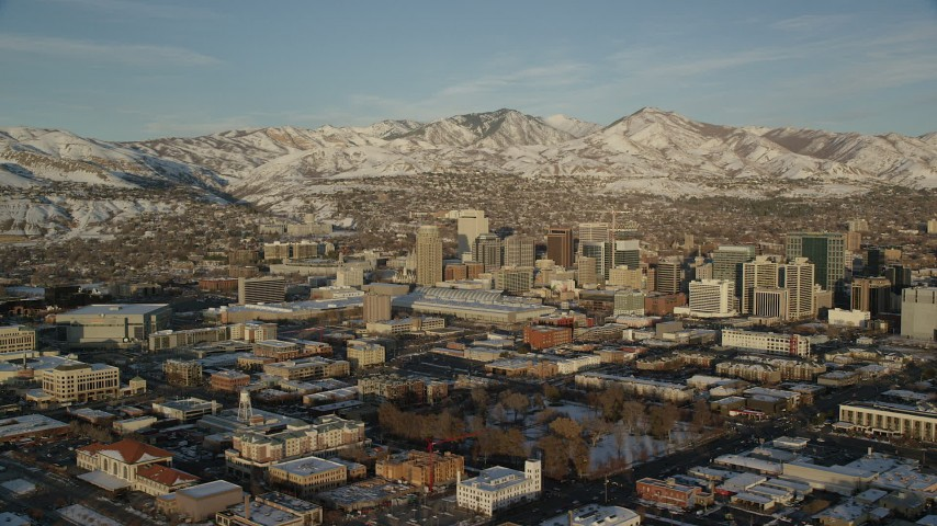 6K stock footage aerial video of wide orbit of Downtown Salt Lake City with winter snow at sunset, Utah Aerial Stock Footage | AX127_113