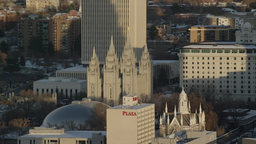 Orbit Salt Lake Temple in Downtown at Sunset in Wintertime Aerial Stock Footage | AX127_115