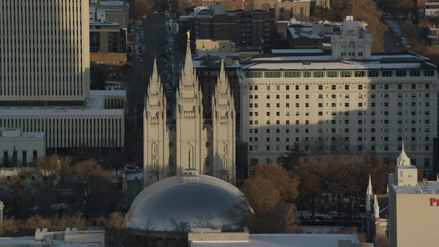 6K stock footage aerial video orbit of Salt Lake Temple at sunset with wintertime snow, Salt Lake City, Utah Aerial Stock Footage AX127_116 | Axiom Images