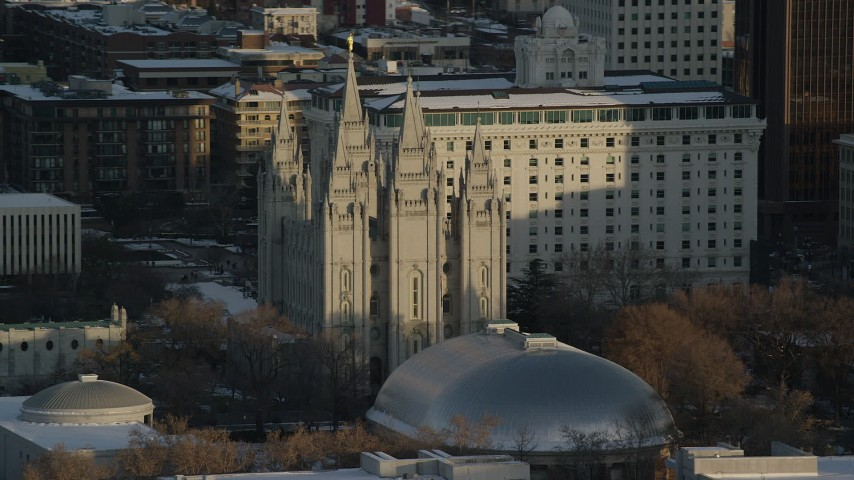Orbiting Salt Lake Temple at Sunset with Winter Snow Aerial Stock Footage | AX127_117