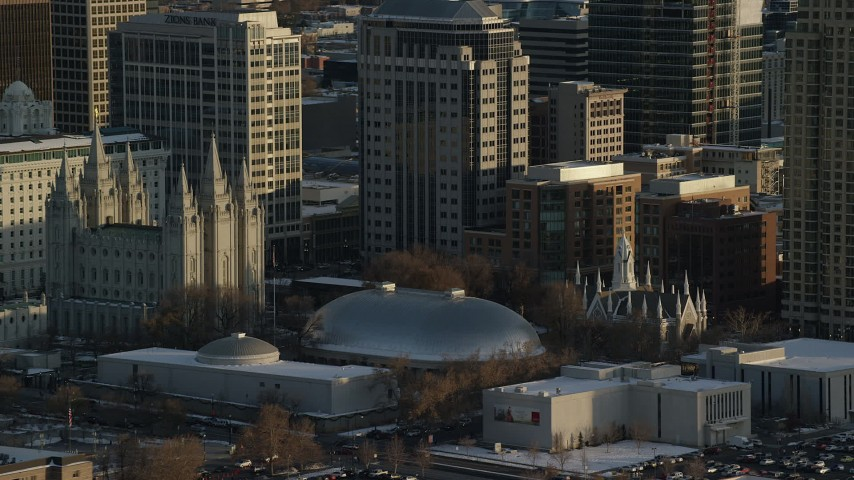 Orbit Salt Lake Temple, Tabernacle and Assembly Hall at Sunset with Winter Snow Aerial Stock Footage | AX127_119