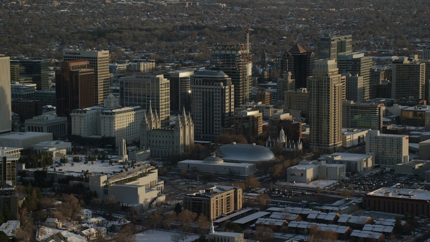 6K stock footage aerial video of Salt Lake Temple, Tabernacle, Assembly Hall and Downtown Salt Lake City, Utah at sunset in winter Aerial Stock Footage AX127_120 | Axiom Images