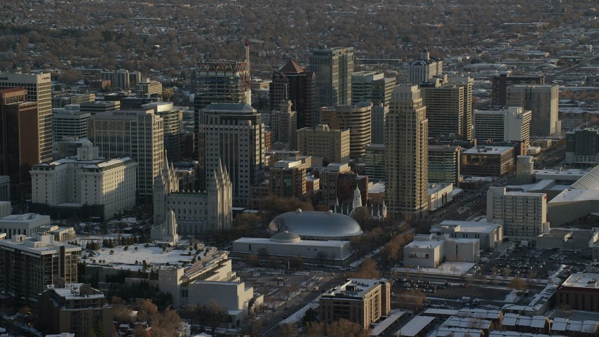 6K stock footage aerial video of circling Salt Lake Temple, Tabernacle and Assembly Hall in downtown with winter snow at sunset, Utah Aerial Stock Footage   AX127_121