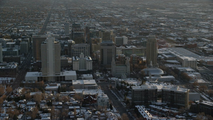 6K stock footage aerial video orbit Joseph Smith Building, Salt Lake Temple and Tabernacle in downtown with winter snow at sunset, Utah Aerial Stock Footage | AX127_123