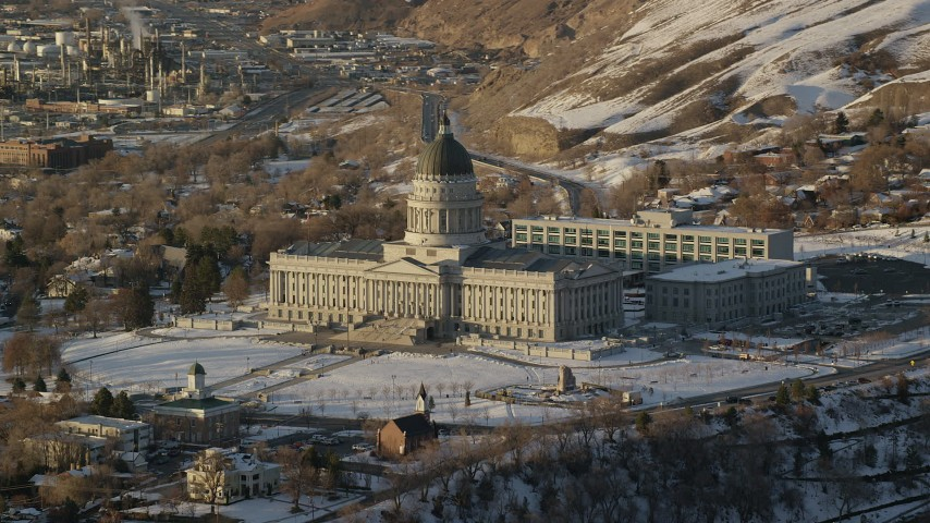 Fly Away from the Utah State Capitol with Winter Snow at Sunset Aerial Stock Footage | AX127_126