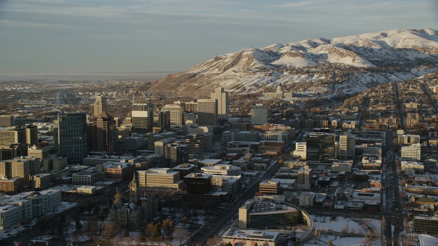 6K stock footage aerial video of reverse view of Utah State Capitol, Downtown Salt Lake in winter at sunset Aerial Stock Footage | AX127_129