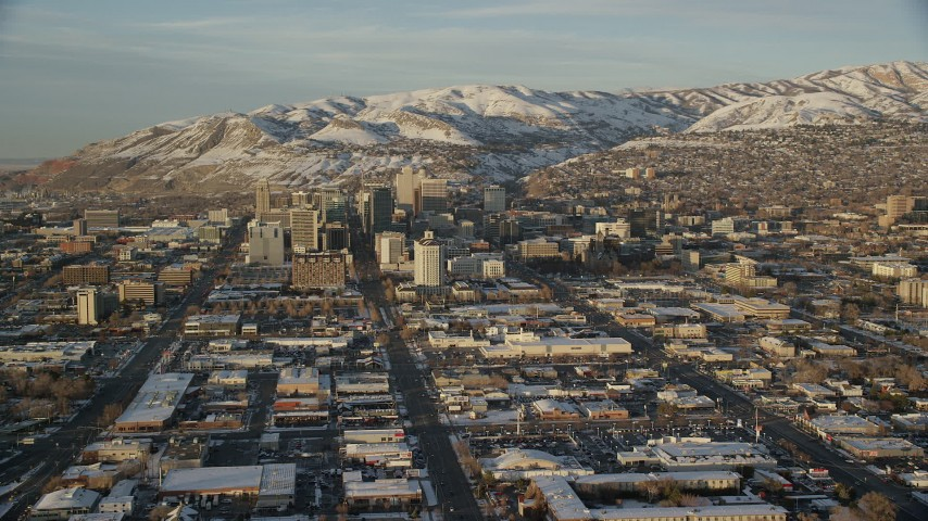 6K stock footage aerial video approach Main and State Streets through Downtown Salt Lake City, Utah, sunset in winter Aerial Stock Footage | AX127_133