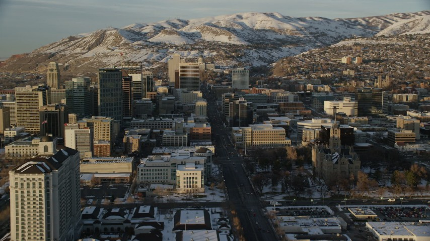 Following State Street through Downtown toward the State Capitol at Sunset in Winter Aerial Stock Footage | AX127_136