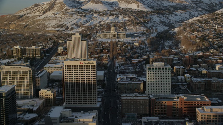6K stock footage aerial video approach Utah State Capitol at the end of State Street at sunset with winter snow, Salt Lake City Aerial Stock Footage AX127_138 | Axiom Images