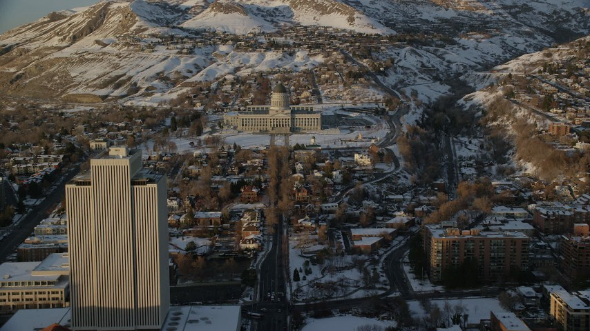 Fly Over State Street toward Utah State Capitol with Winter Snow at Sunset Aerial Stock Footage | AX127_139