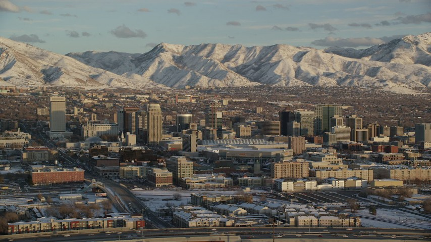 6K stock footage aerial video of orbiting Downtown Salt Lake City at sunset with winter snow, Utah Aerial Stock Footage | AX127_149