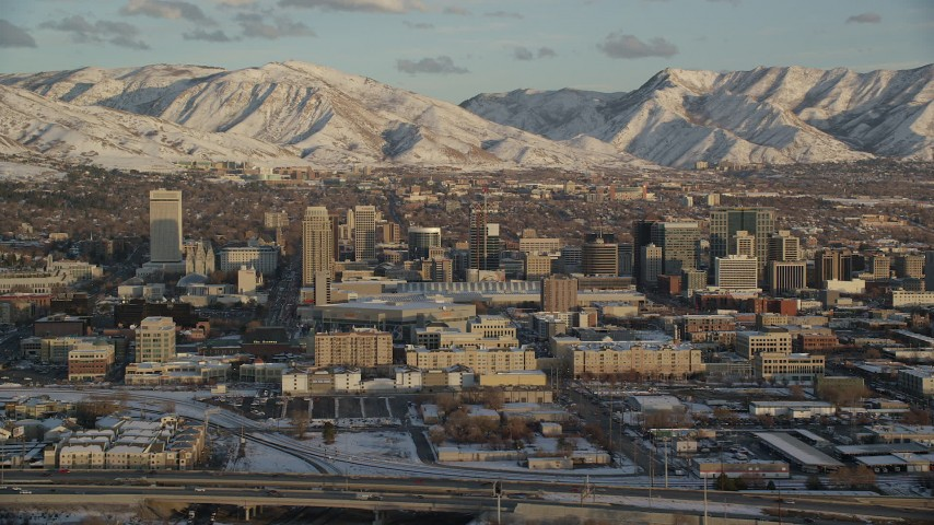 6K stock footage aerial video orbit Downtown Salt Lake City with winter snow at sunset, Utah Aerial Stock Footage | AX127_150