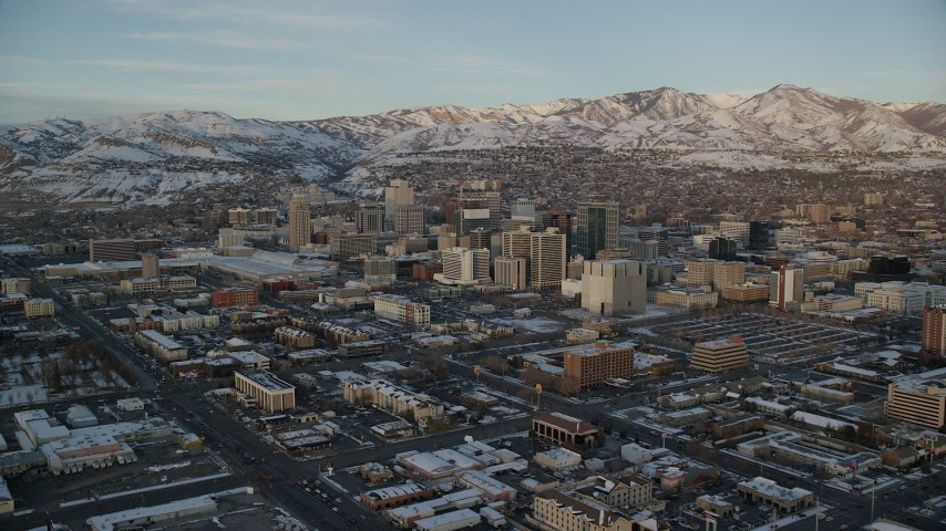 6K stock footage aerial video of tall Downtown Salt Lake City buildings seen from 400 West at sunset in winter, Utah Aerial Stock Footage | AX127_158