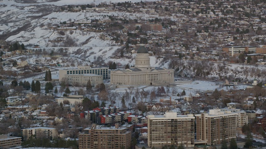 6K stock footage aerial video orbit west side of Utah State Capitol with winter snow at sunset, Salt Lake City Aerial Stock Footage | AX127_161