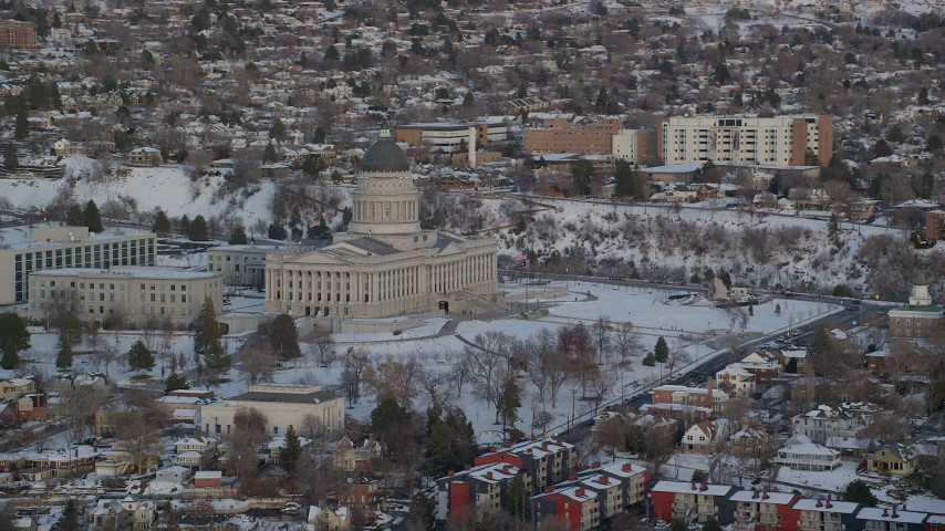 6K stock footage aerial video orbit the Utah State Capitol Building with winter snow at sunset, Salt Lake City Aerial Stock Footage | AX127_162