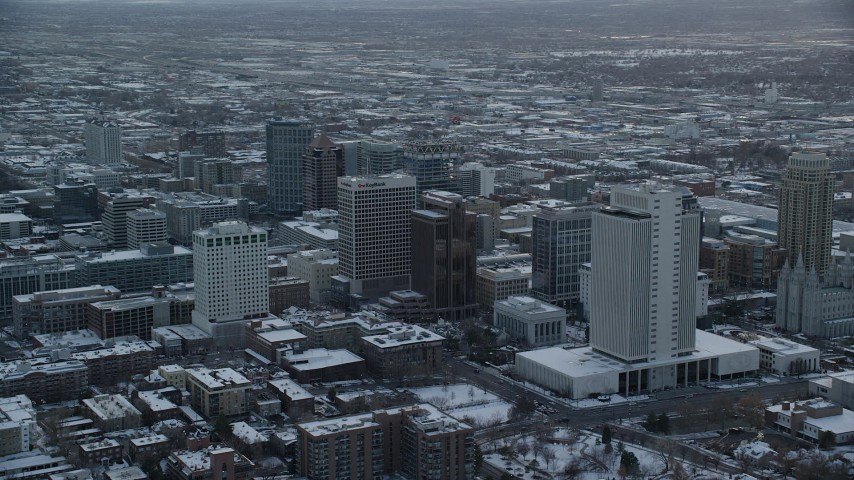 6K stock footage aerial video orbit and approach buildings in Downtown Salt Lake City at sunset in winter, Utah Aerial Stock Footage | AX127_165