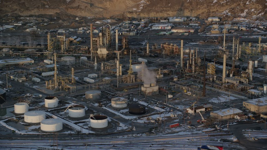 Circling the Tesoro Refinery in Salt Lake City with Winter Snow at Sunset Aerial Stock Footage | AX127_169