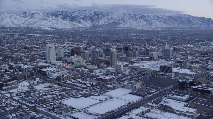 Orbiting Downtown SLC with Winter Snow on the Ground at twilight Aerial Stock Footage | AX128_005
