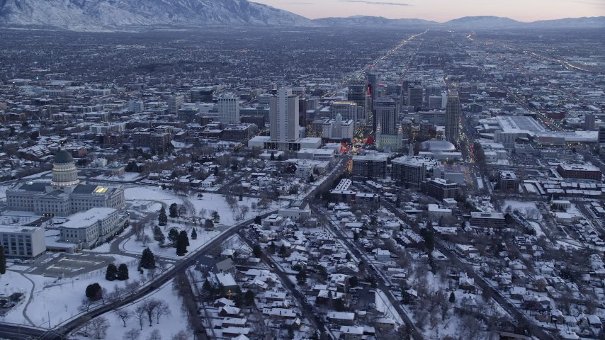 6K stock footage aerial video orbit Downtown Salt Lake City and reveal the state capitol with winter snow at twilight, Utah Aerial Stock Footage | AX128_007