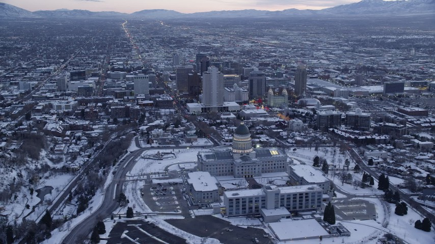6K stock footage aerial video orbit Utah State Capitol and Downtown SLC with winter snow at twilight Aerial Stock Footage | AX128_008