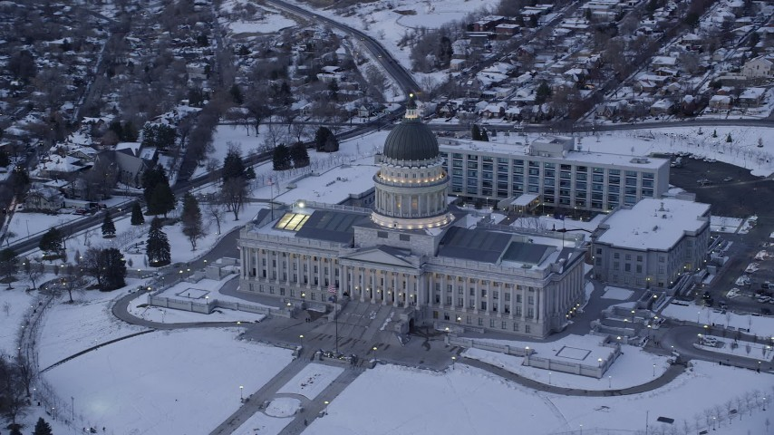 6K stock footage aerial video orbit front of Utah State Capitol with winter snow at twilight, Salt Lake City Aerial Stock Footage | AX128_010