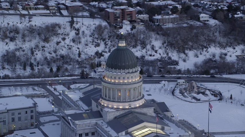 Orbit Dome of State Capitol at twilight with Winter Snow on Ground Aerial Stock Footage | AX128_013