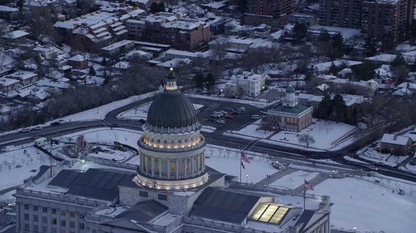 Circling Dome of the Utah State Capitol at twilight in Wintertime Aerial Stock Footage | AX128_014