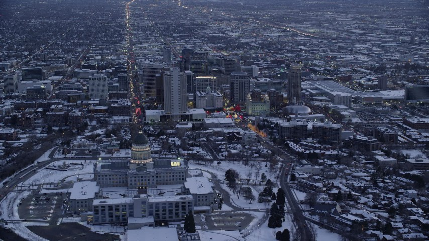 6K stock footage aerial video approach north side of state capitol and Downtown SLC with snow at twilight, Utah Aerial Stock Footage | AX128_017