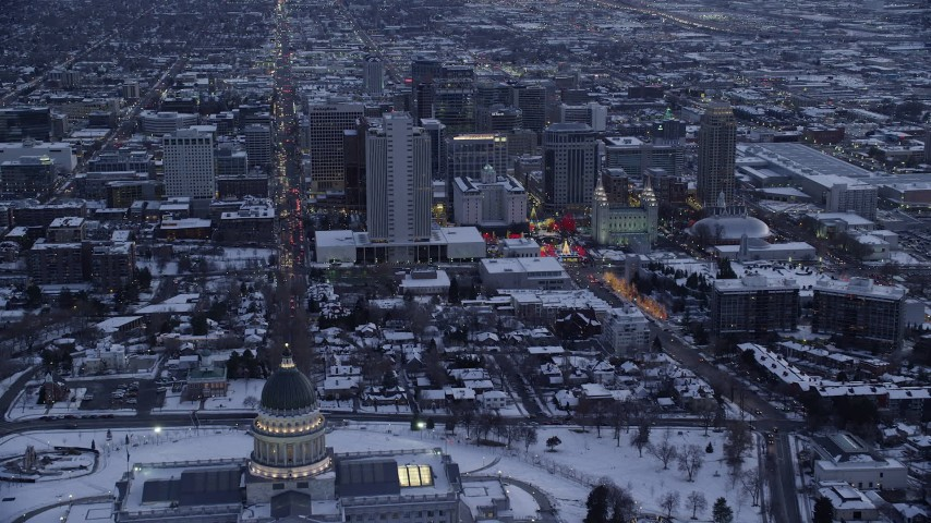 6K stock footage aerial video fly over state capitol toward State Street and Downtown Salt Lake City at twilight with winter snow, Utah Aerial Stock Footage | AX128_018