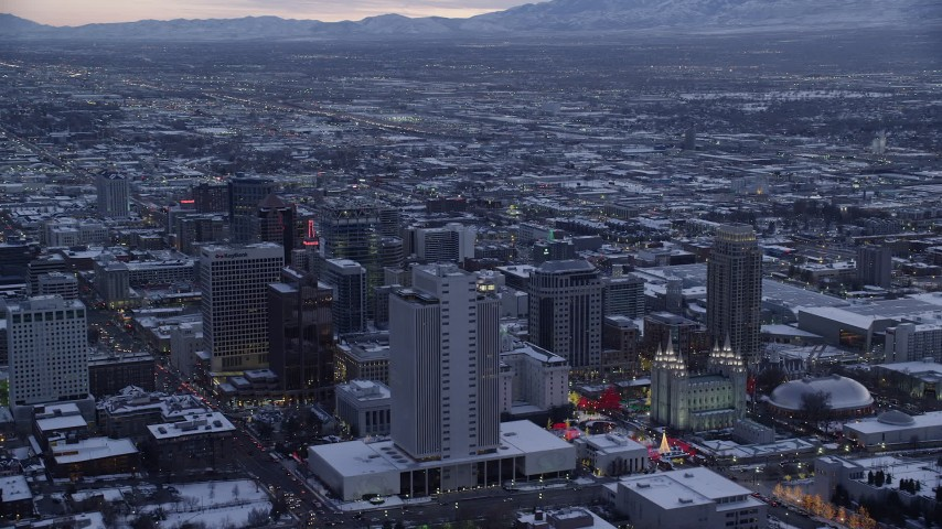6K stock footage aerial video orbit Church Office Building and temple in Downtown Salt Lake City with winter snow at twilight, Utah Aerial Stock Footage | AX128_019