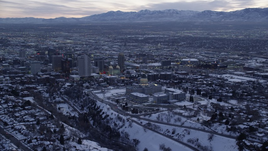 6K stock footage aerial video orbit the Utah State Capitol Building near Downtown SLC with winter snow at twilight Aerial Stock Footage | AX128_021