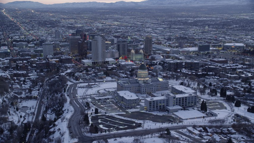 Approach State Capitol, Church Office Building and the Temple in Downtown at twilight Aerial Stock Footage | AX128_022