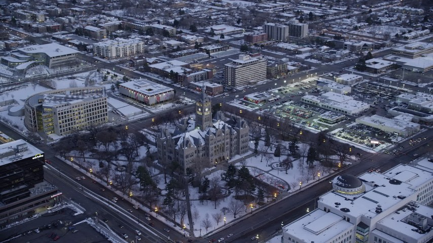 Orbit Salt Lake City Hall with Winter Snow at twilight Aerial Stock Footage | AX128_027