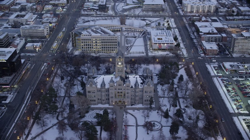 6K stock footage aerial video orbit city hall in Downtown Salt Lake City with winter snow at sunset, Utah Aerial Stock Footage | AX128_028