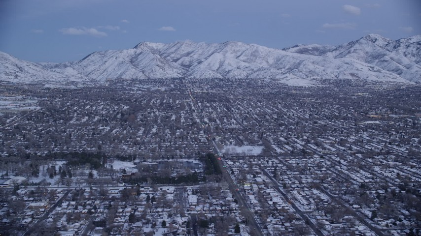 6K stock footage aerial video of Salt Lake City suburban neighborhoods near Liberty Park with winter snow at twilight, Utah Aerial Stock Footage | AX128_030