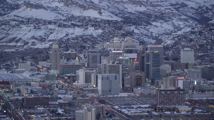 Orbit Downtown Buildings and State Capitol in Background in Wintertime at twilight Aerial Stock Footage | AX128_031