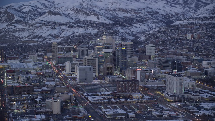6K stock footage aerial video orbit Downtown Salt Lake City with winter snow seen from West Temple Street at twilight, Utah Aerial Stock Footage | AX128_039