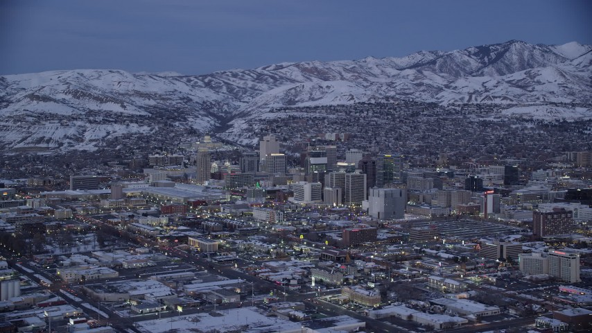 6K stock footage aerial video wide orbit of Downtown Salt Lake City with winter snow seen from the southwest at twilight, Utah Aerial Stock Footage | AX128_041