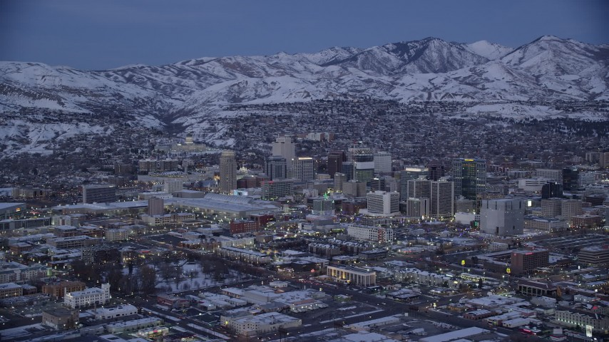 6K stock footage aerial video a wide orbit of Downtown Salt Lake City and convention center with winter snow at twilight, Utah Aerial Stock Footage | AX128_042