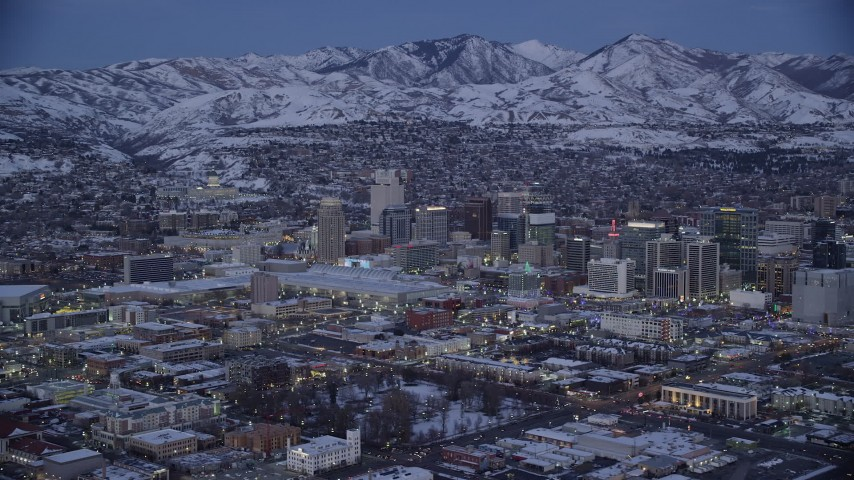 6K stock footage aerial video orbit near convention center in Downtown SLC with winter snow at twilight, Utah Aerial Stock Footage | AX128_043