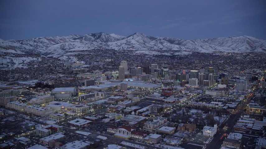 6K stock footage aerial video of a wide orbit of Downtown Salt Lake City seen from The Gateway in winter at twilight Aerial Stock Footage | AX128_044
