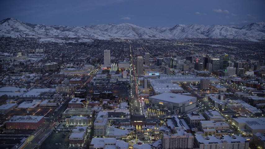 6K stock footage aerial video orbit arena and convention center on the west side of Downtown SLC, Utah with winter snow at twilight Aerial Stock Footage | AX128_046