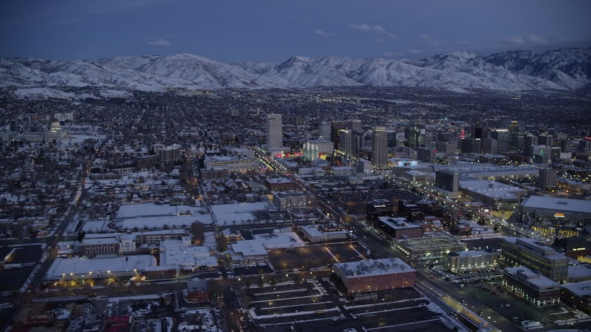 6K stock footage aerial video of a wide orbit of capitol and Downtown Salt Lake City with winter snow at twilight, Utah Aerial Stock Footage | AX128_047