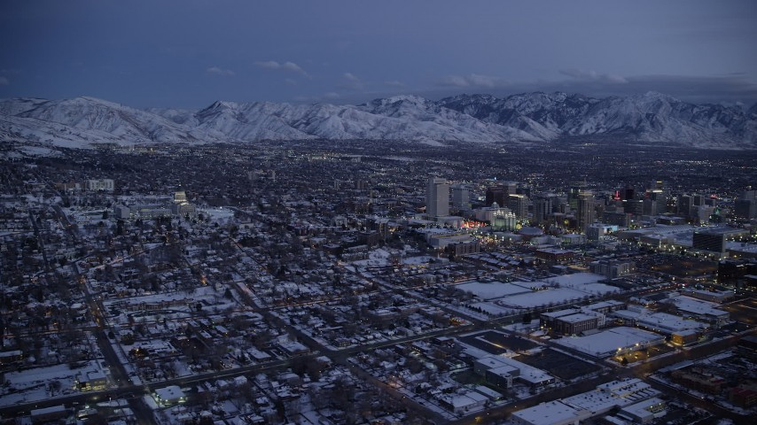 6K stock footage aerial video wide orbit of Downtown Salt Lake City seen from the northwest near the capitol in winter at twilight, Utah Aerial Stock Footage | AX128_048