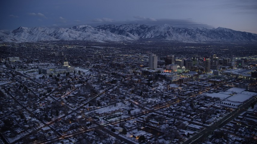 6K stock footage aerial video of orbiting Utah State Capitol by Downtown Salt Lake City with winter snow at twilight Aerial Stock Footage | AX128_049