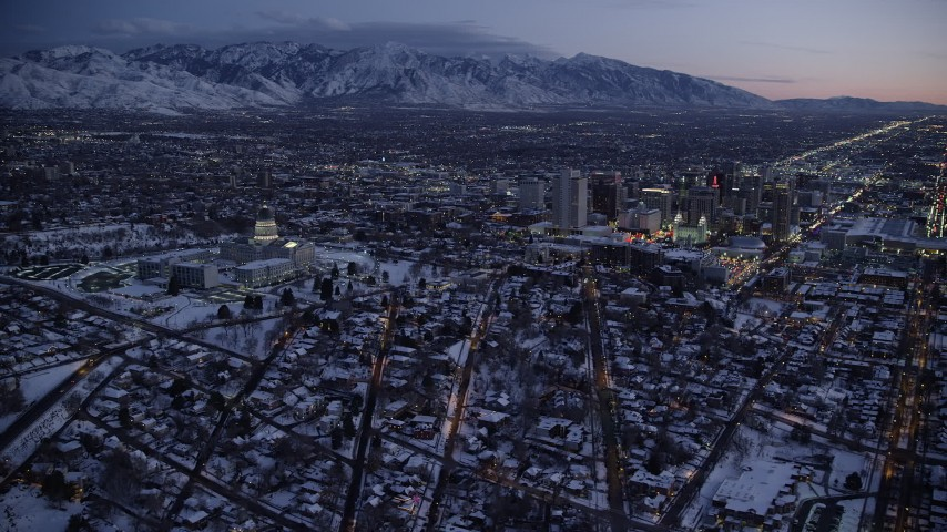 6K stock footage aerial video of circling north of the Utah State Capitol building and Downtown Salt Lake City with winter snow at twilight Aerial Stock Footage | AX128_050