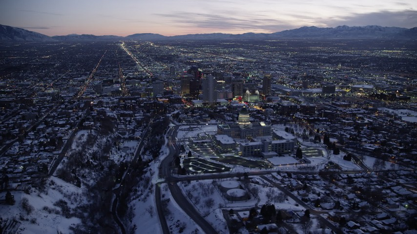 6K stock footage aerial video of orbiting around the Utah State Capitol, Downtown SLC with winter snow at twilight Aerial Stock Footage | AX128_052