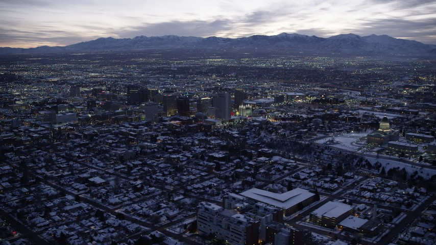 Orbit Downtown and the Capitol with Winter Snow at twilight Aerial Stock Footage | AX128_054